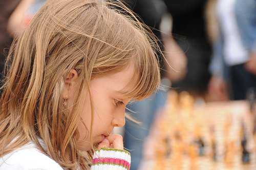 girl playing chess happiness