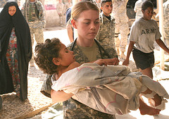 Marine carrying child