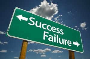 Success and Failure Road Sign with dramatic clouds and sky.
