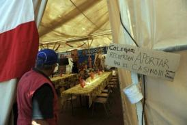 Relative of a trapped miner    entering dining tent