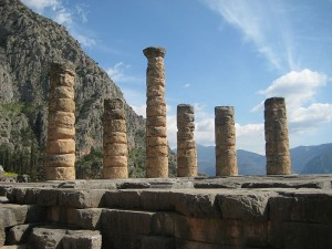 "Remaining columns of Temple of Apollo at Delphi, where it was carved, ""γνῶθι σεαυτόν"" or ""Know thyself."""